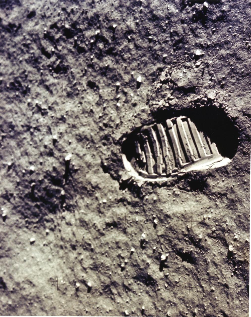 "This is a close-up view of an astronaut's footprint in the lunar soil, photographed by a 70 mm lunar surface camera during the Apollo 11 lunar surface extravehicular activity. The first manned lunar mission, the Apollo 11 launched aboard a Saturn V launch vehicle from the Kennedy Space Center, Florida on July 16, 1969 and safely returned to Earth on July 24, 1969. The 3-man crew aboard the flight consisted of Neil A, Armstrong, mission commander; Edwin E. Aldrin, Jr., Lunar Module Pilot; and Michael Collins, Command Module pilot. The LM landed on the moon's surface on July 20, 1969 in the region known as Mare Tranquilitatis (the Sea of Tranquility). Armstrong was the first human to ever stand on the lunar surface. As he stepped off the LM, Armstrong proclaimed, ""That's one small step for man, one giant leap for mankind"". He was followed by Edwin (Buzz) Aldrin, describing the lunar surface as Magnificent desolation. Astronaut Collins piloted the Command Module in a parking orbit around the Moon. The crew collected 47 pounds of lunar surface material which was returned to Earth for analysis. The surface exploration was concluded in 2½ hours. With the success of Apollo 11, the national objective to land men on the Moon and return them safely to Earth had been accomplished. The Saturn V vehicle was developed by the Marshall Space Flight Center (MSFC) under the direction of Dr. von Braun."