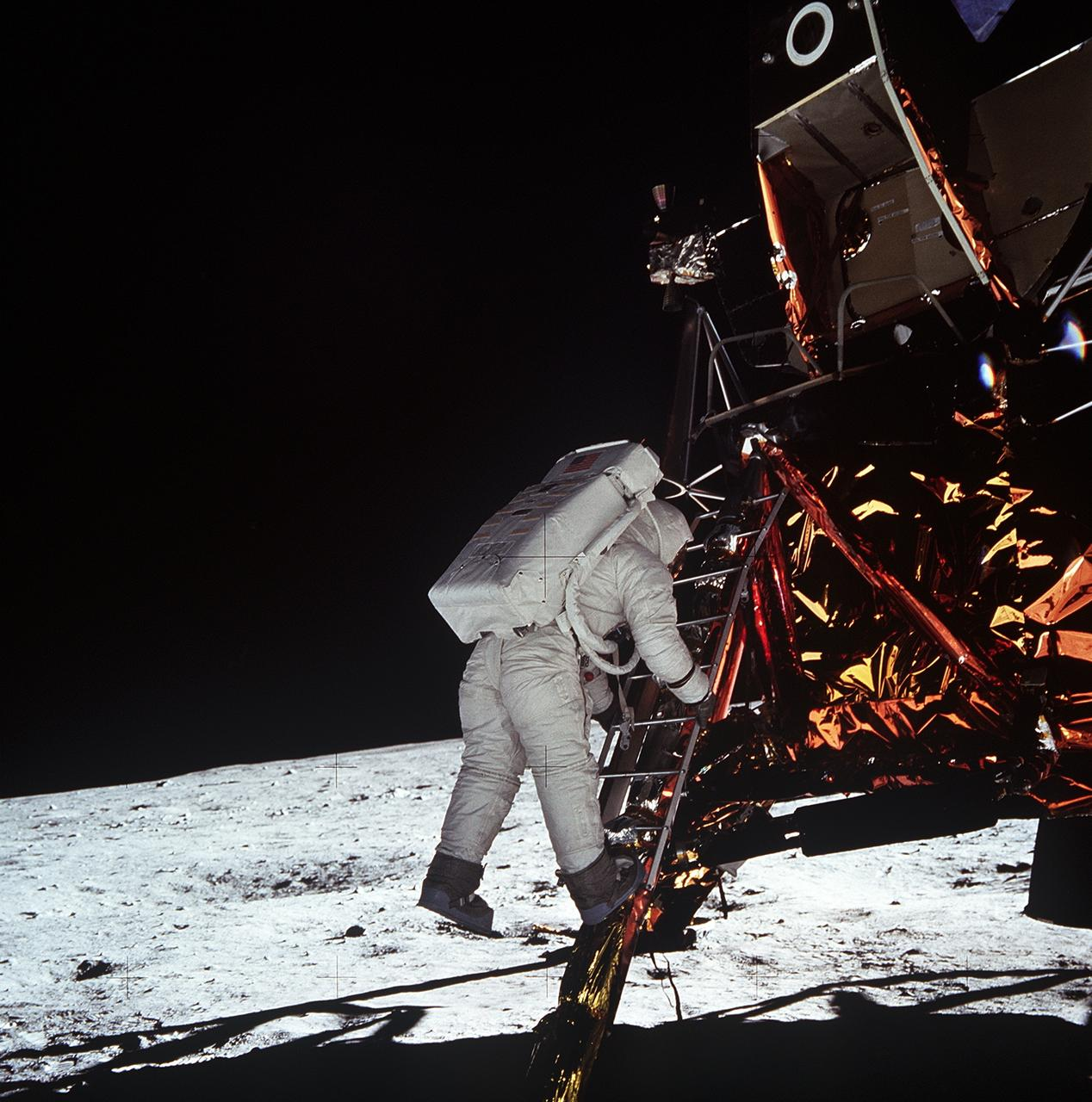 (20 July 1969) --- Astronaut Edwin E. Aldrin Jr., lunar module pilot, descends the steps of the Lunar Module (LM) ladder as he prepares to walk on the moon. He had just egressed the LM. This photograph was taken by astronaut Neil A. Armstrong, commander, with a 70mm lunar surface camera during the Apollo 11 extravehicular activity (EVA). While Armstrong and Aldrin descended in the LM